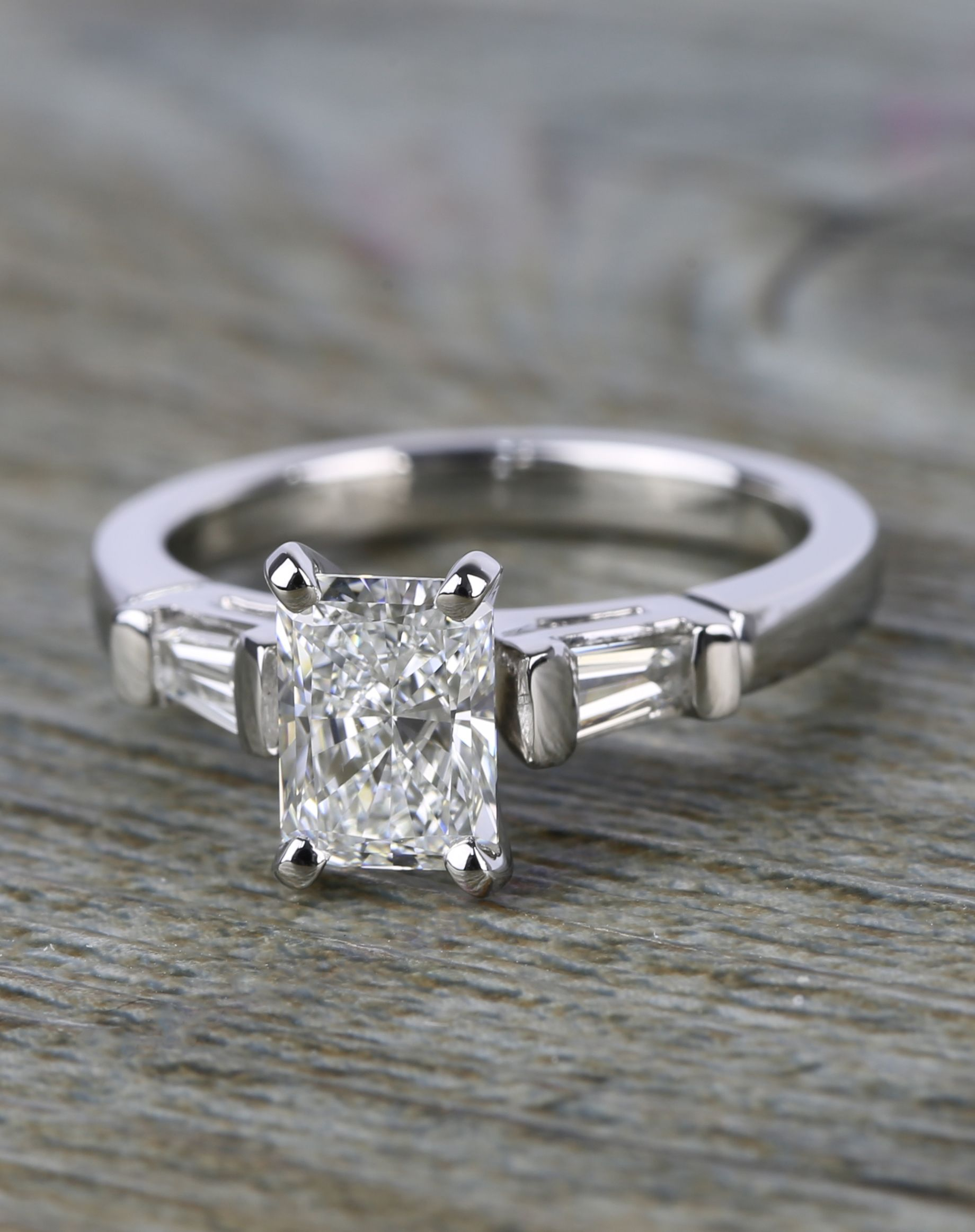 9ce68c8e4d3917 The colorless radiant cut diamond in this platinum engagement ring  completely modernizes this once vintage look. Tapered baguettes frame the center  diamond.