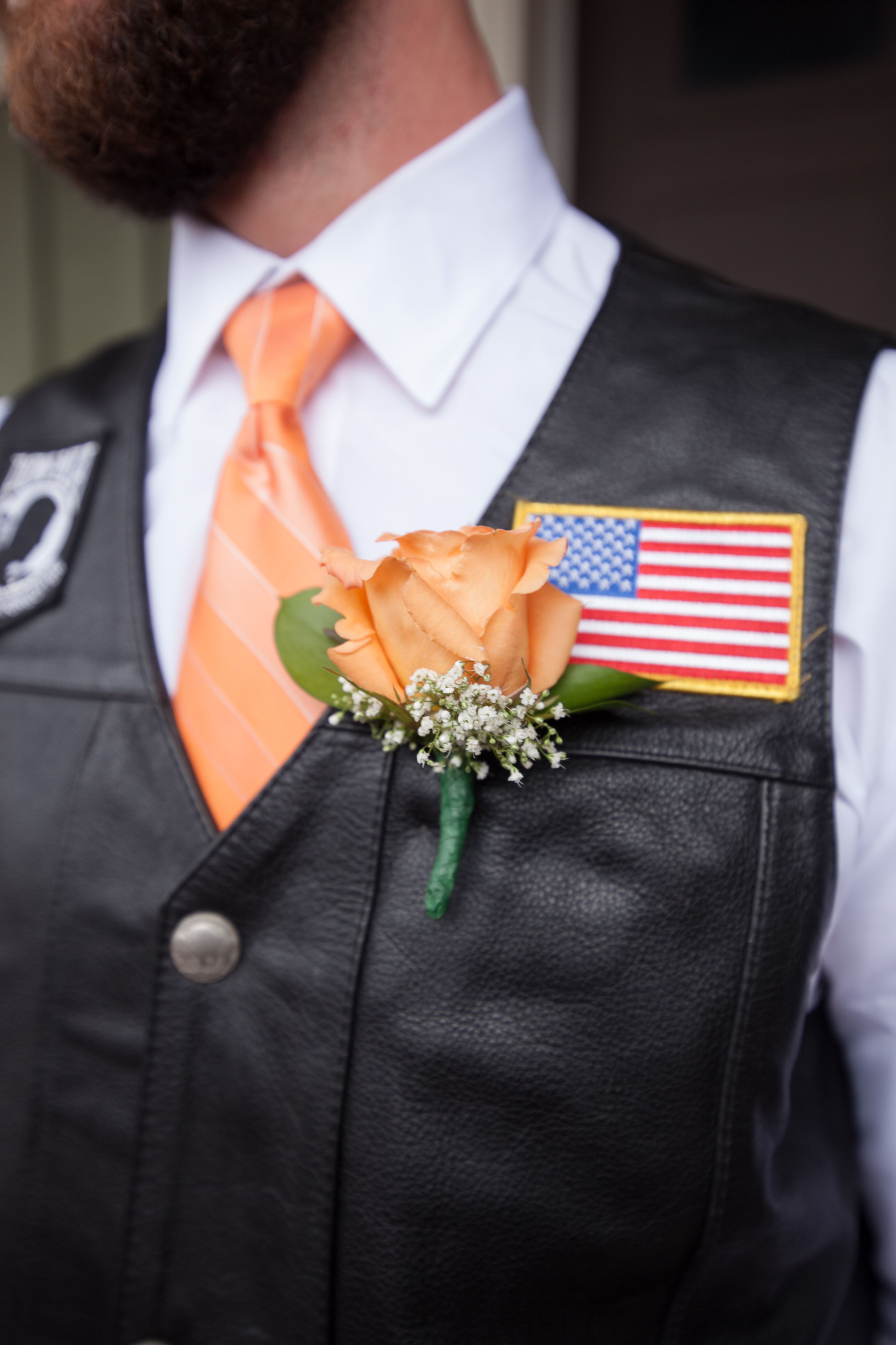Harley Davidson Boutonniere With An Orange Rose And Baby S Breath The Groom Wore A White Shirt Orang Motorcycle Wedding Biker Wedding Harley Davidson Wedding