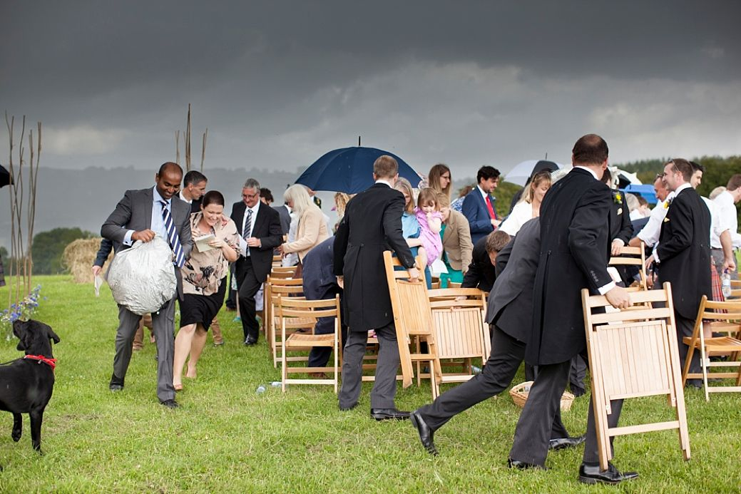 Wedding Guests Running From The Rain During Shower In Outdoor Ceremony Somerset Photographer Kerry Bartlet Photography