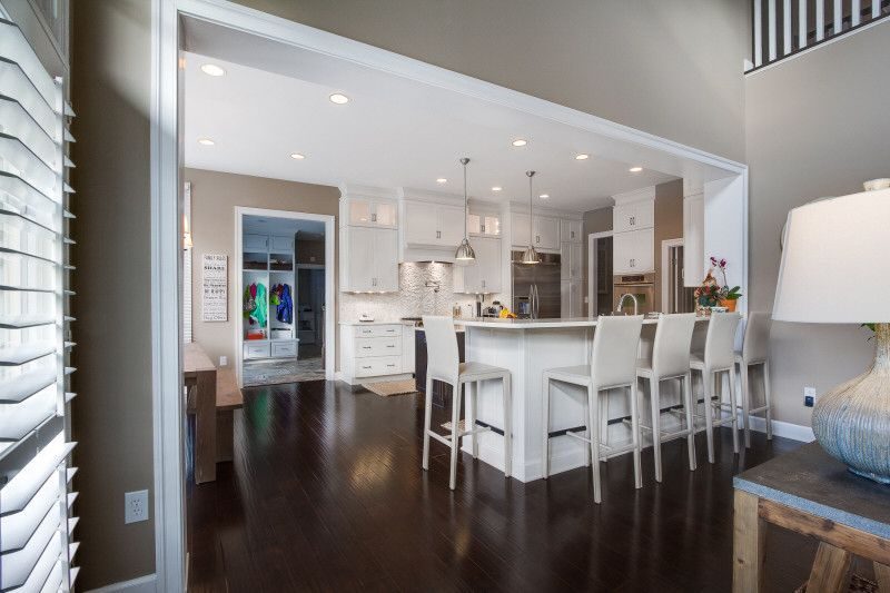 Modern white kitchen with espresso brown wood floors for Flooring columbia md