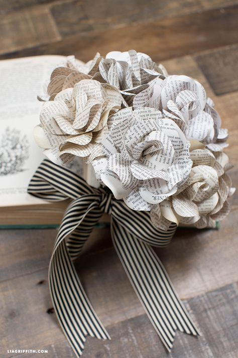 Vintage book page flowers diy paper books and vintage books this super creative bouquet of paper flowers is made with vintage book pages makes for an interesting statement piece template and tutorial by lia griffith mightylinksfo