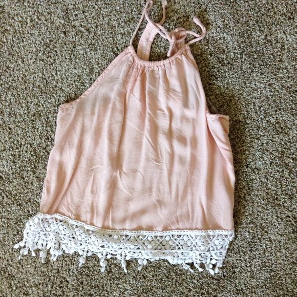 Pink halter top Cute pink halter top with crochet lace detail on the bottom. Brand new condition Tops