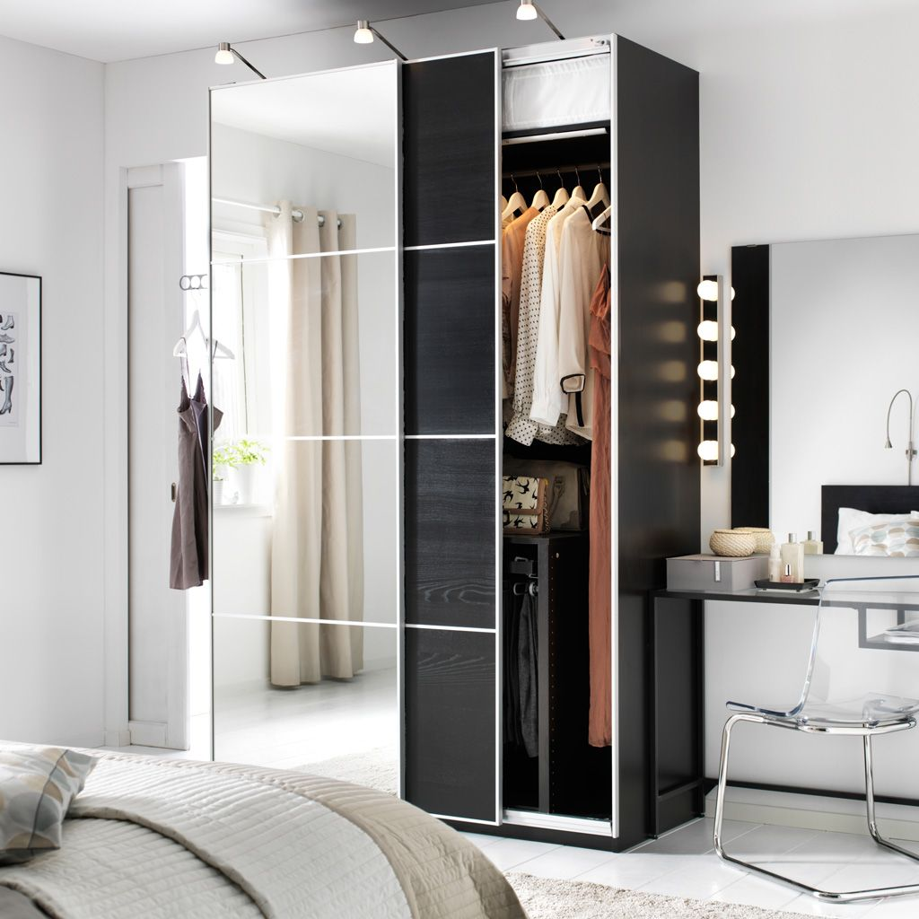 Bedroom Cupboards With Mirror Sliding Doors: A White Bedroom With A Dark PAX Wardrobe Combination With