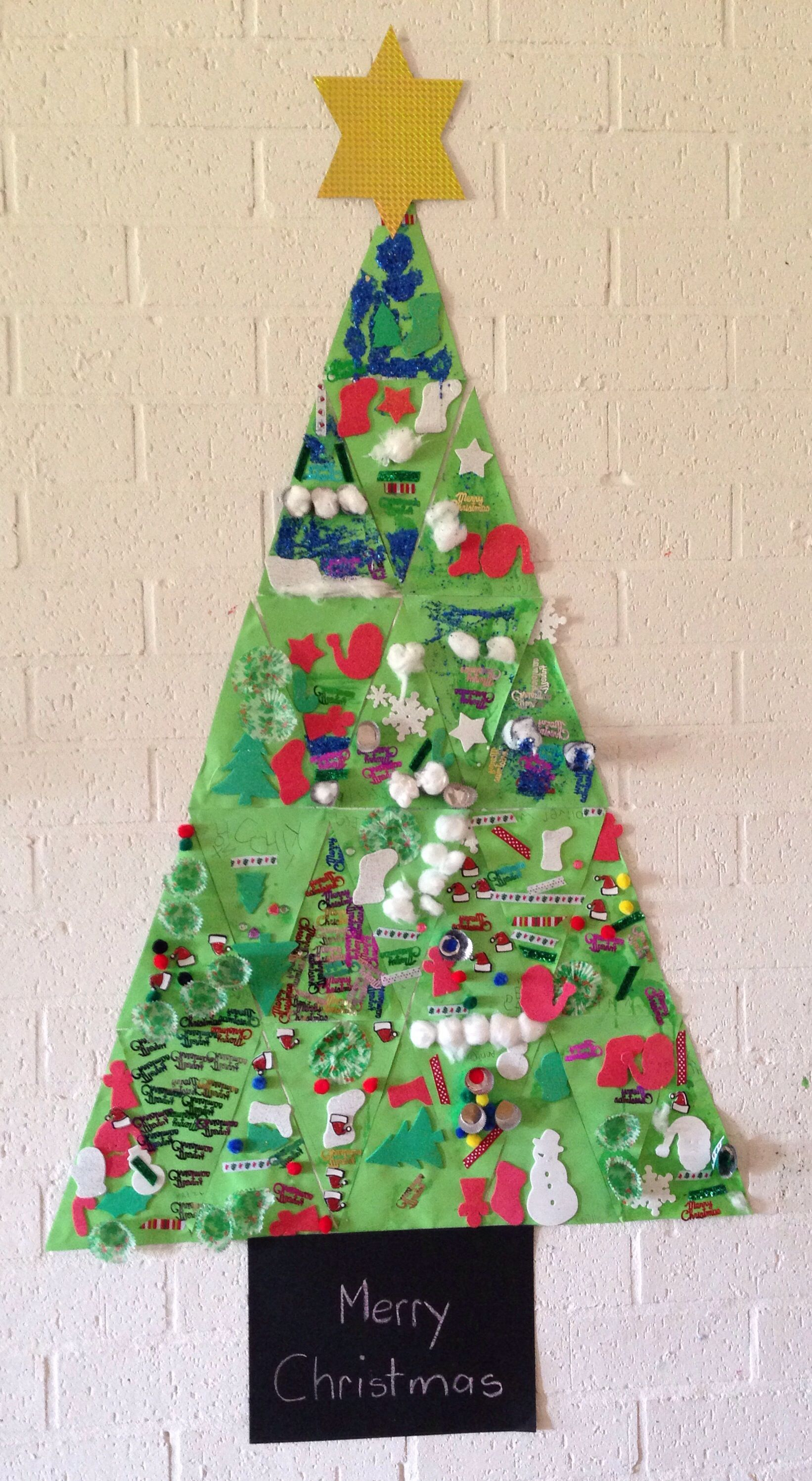Christmas Tree Made From Individual Triangles Decorated By The Children This Week I M Having So Much Felt Christmas Tree Christmas Kindergarten Felt Christmas