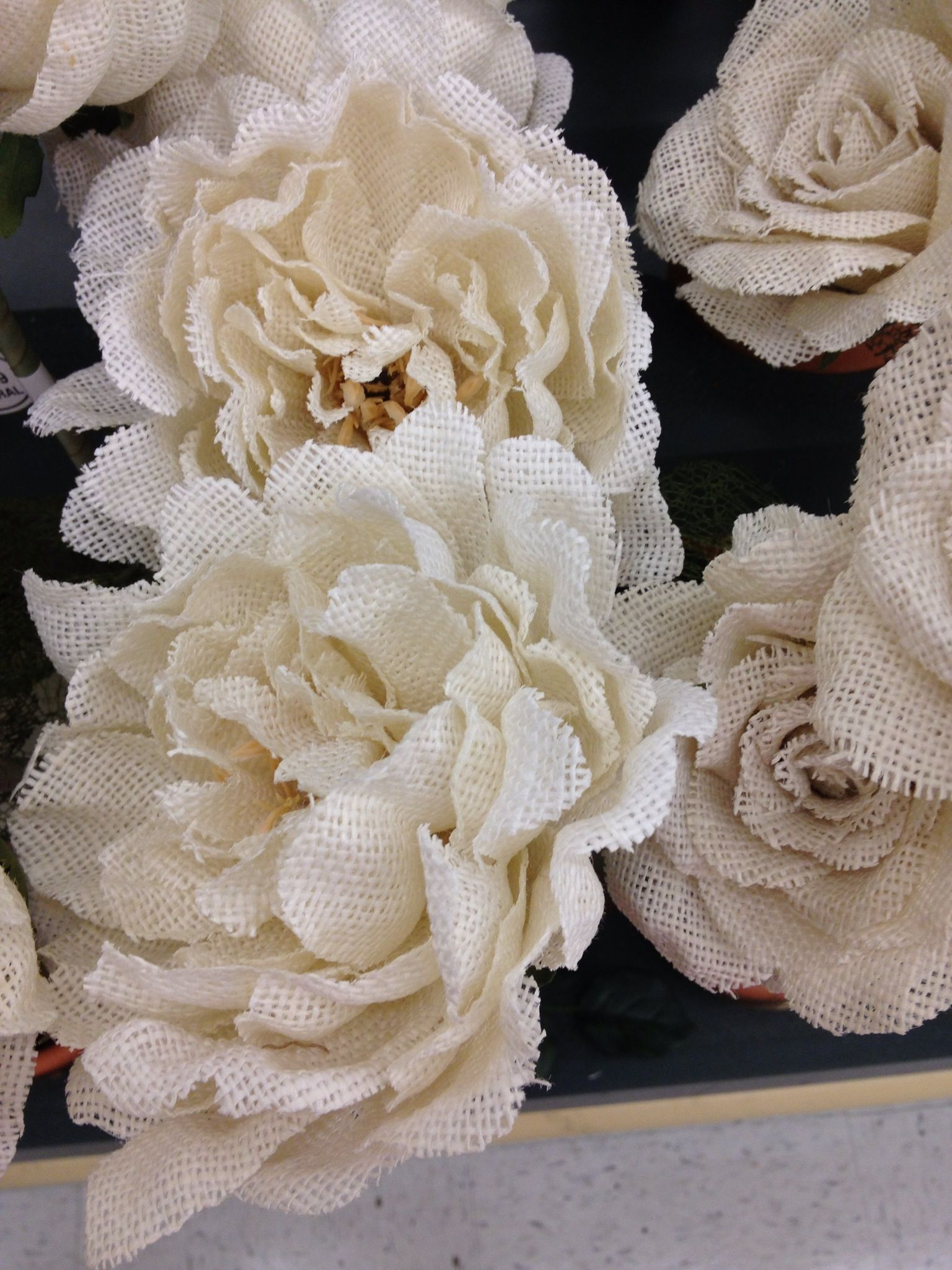 burlap flowers sold by stem at hobby lobby or could make our own
