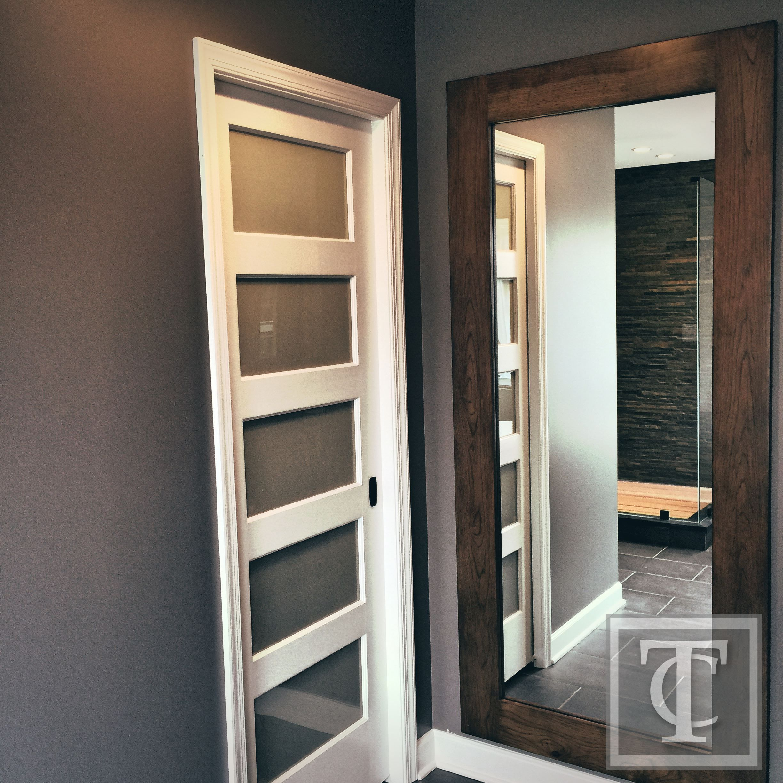 Contemporary Bathroom Doors: Frosted Five Panel Glass Door Covering Toilet Area