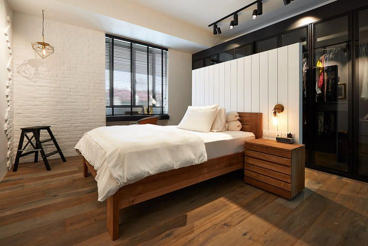 clever design wardrobes for bedroom. Taking up the full wall perimeter behind bed  wardrobe is cleverly concealed while