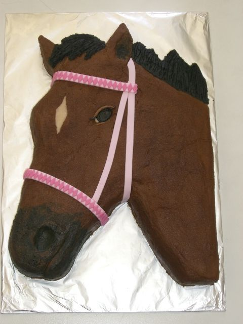 This is for a little 6 year old girl! It is buttercream, with a fondant bridle. It took me a lot longer to do the pattern on the bridle than I expected!!