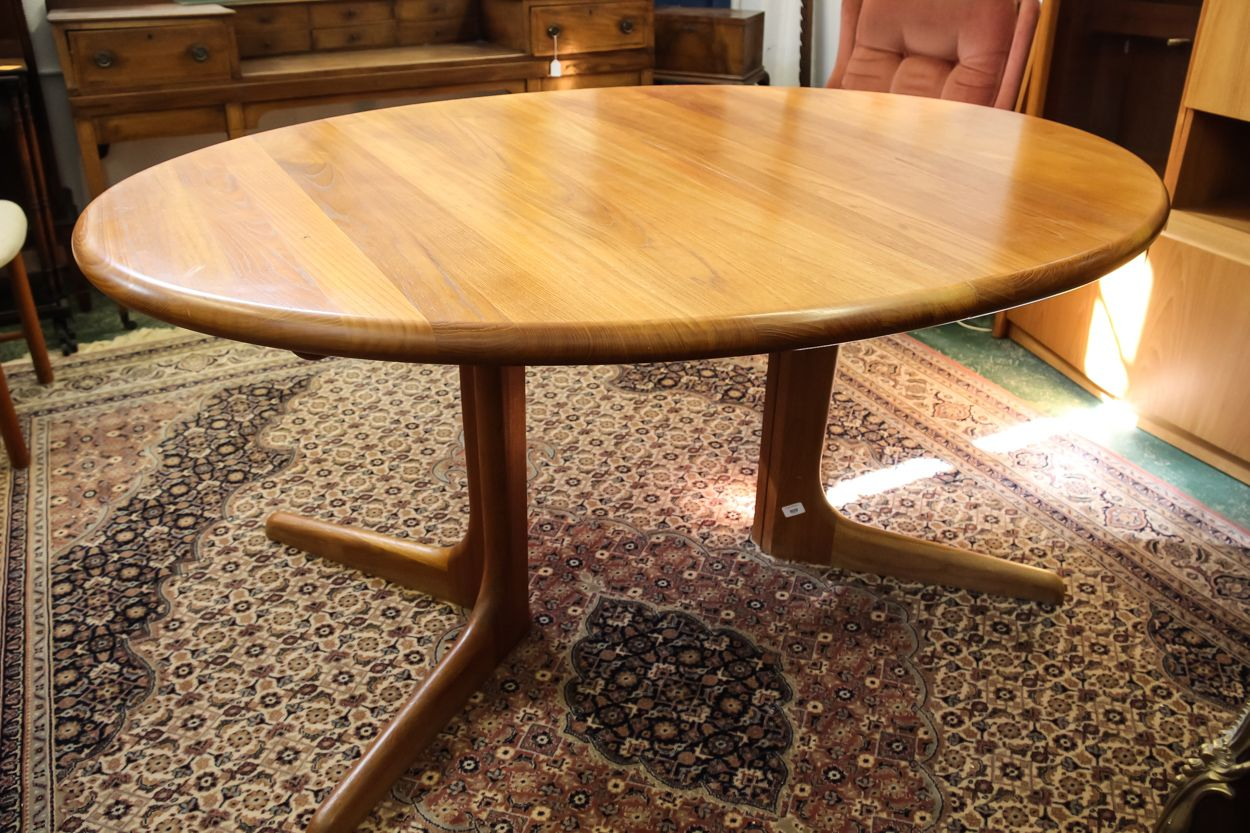 A Benny Linden Danish Oval Teak Dining Table With Two Extra Leaves