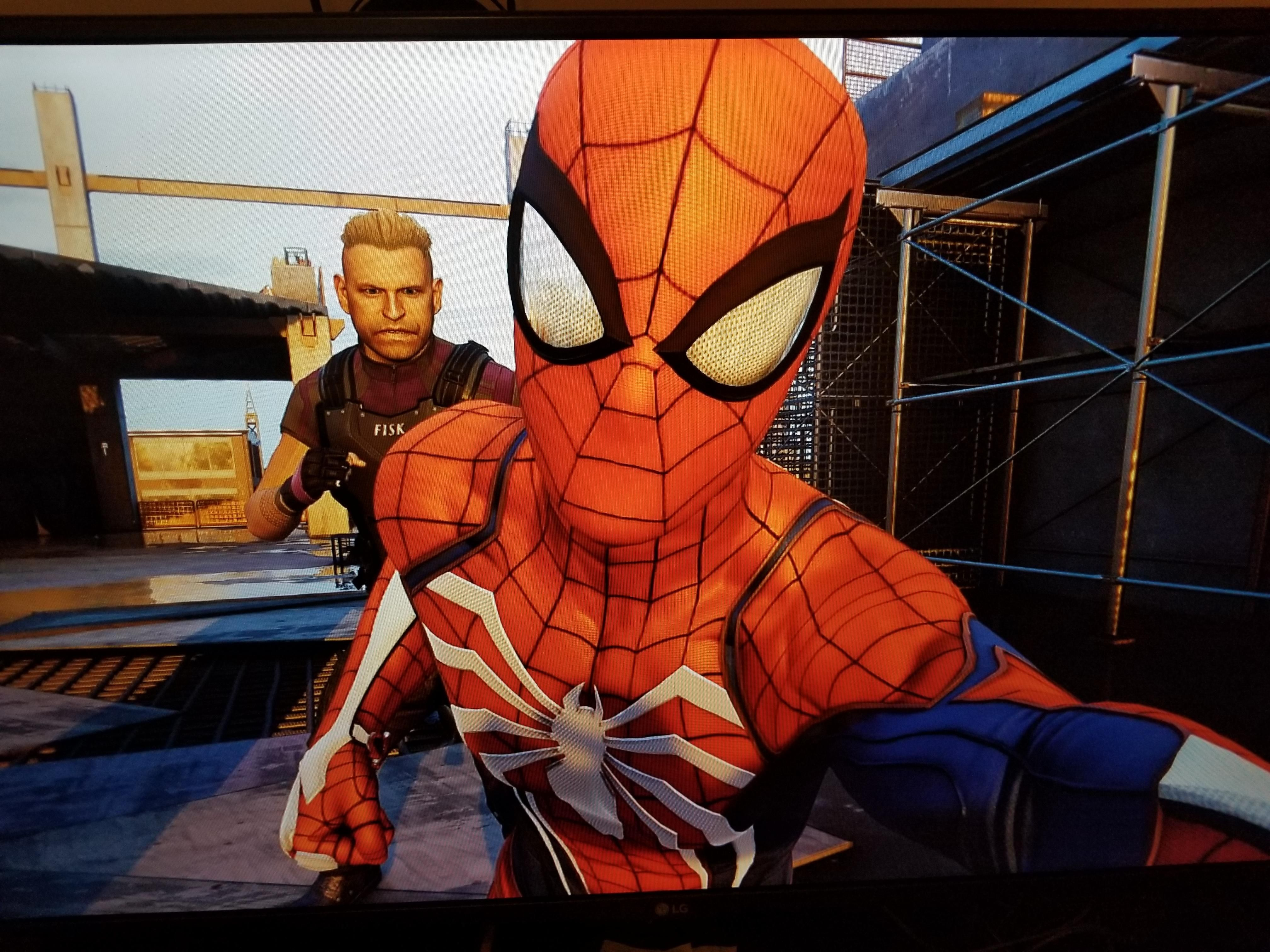 Spiderman casually taking a selfie during a fight