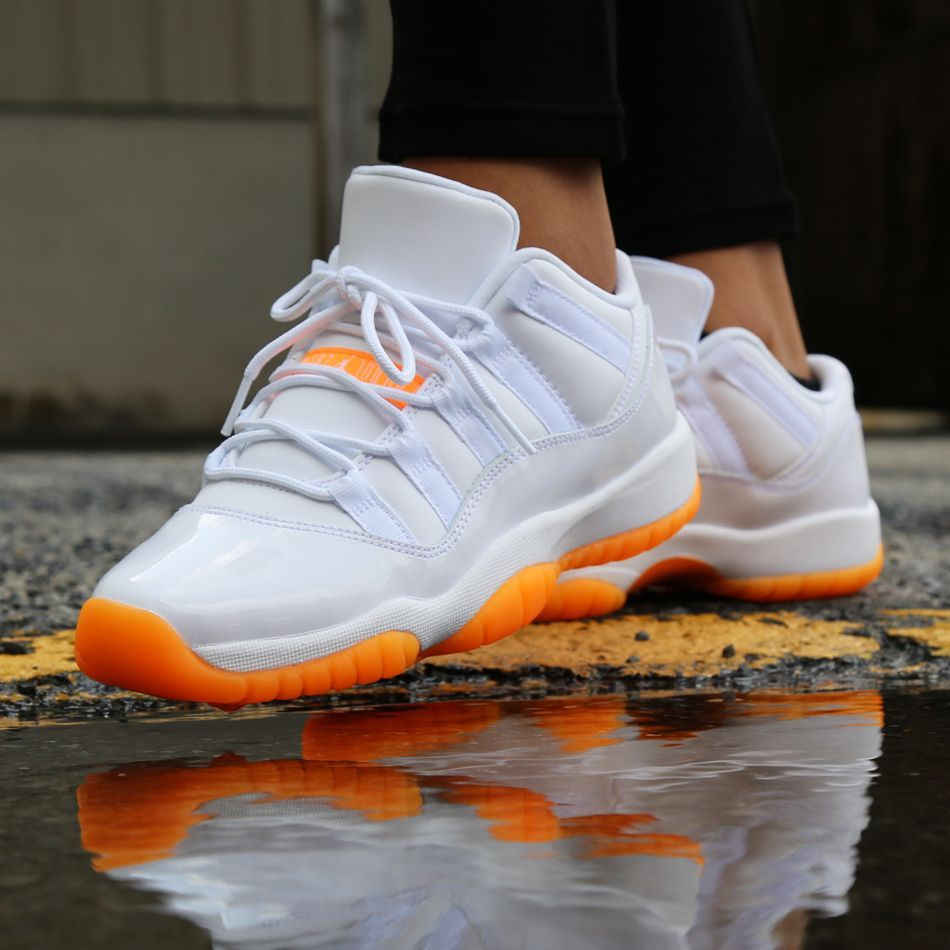 Classic Air Jordan 11 sneaker for kids featuring a white and orange citrus  look for the