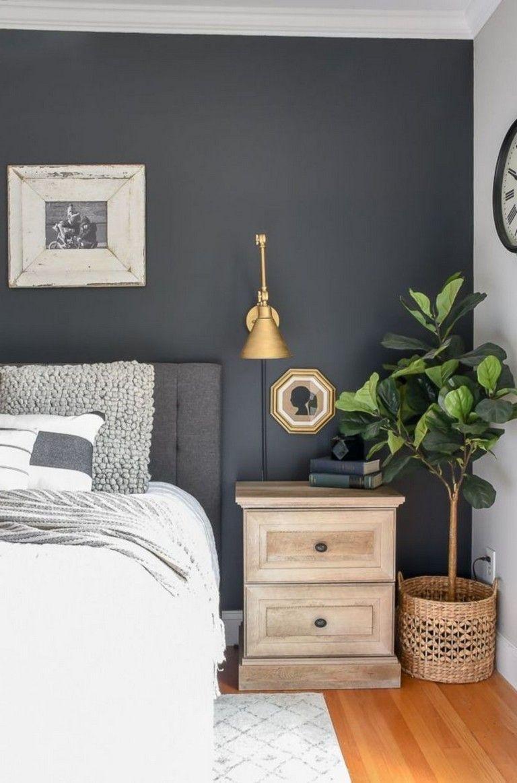 Dark Grey Bedroom Walls Love The Dark Grey Wall In This Bedroom Dark Gray Headboard Bedroom Ideas Gra Vaggar Vardagsrum Graa Vaggar Sovrum Sekelskifte