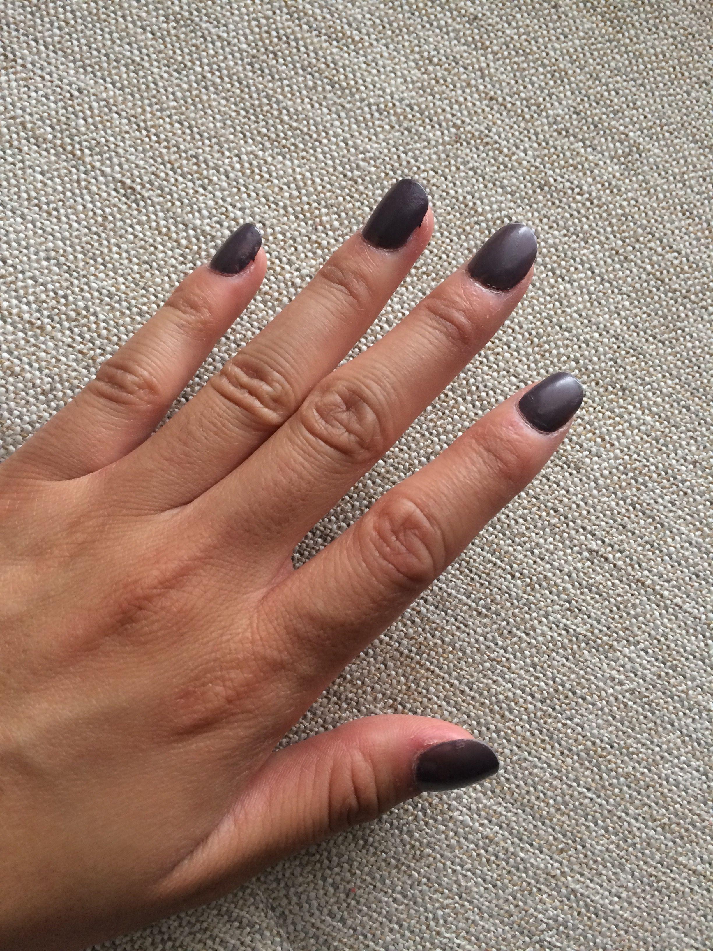 Left hand 9/16/17 glue and nails ... dark grey purple fall polish ...