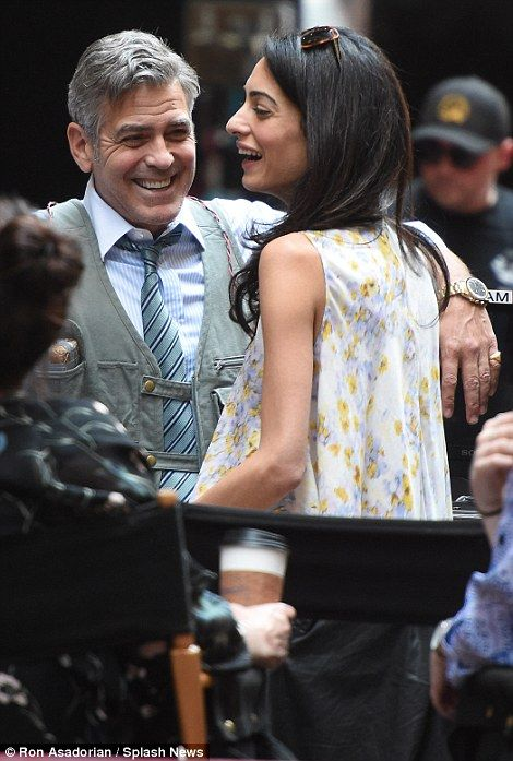 George Clooney shares a laugh with wife Amal as she visits ...