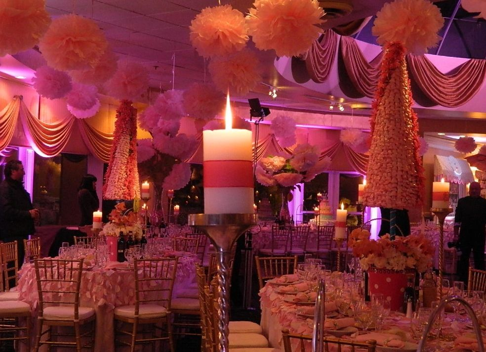 Candy trees, pink pom poms, pink uplighting make this an incredible looking first birthday @Grand Marquis. #1stbirthday, #candytheme, #receptionhallsnj, #banquethallsnj, #weddingvenuesnj.