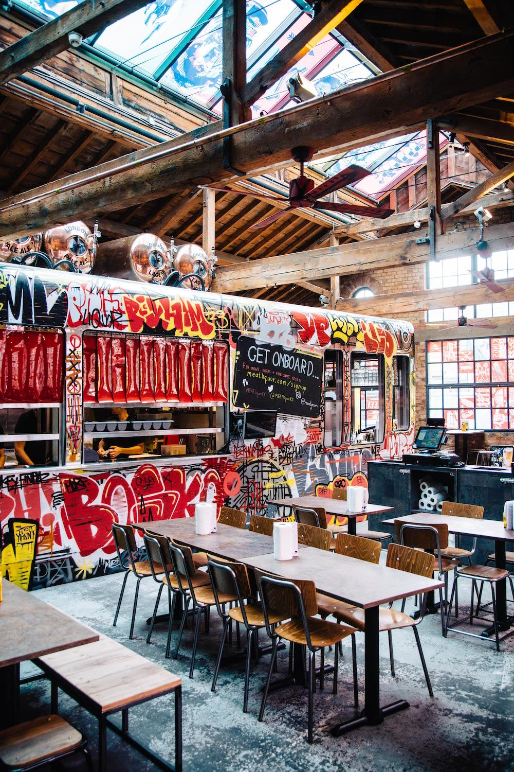 Meat Liquor Kings Cross Shed Interior Architecture Design Meatliquor Restaurant In London With Graffiti And Train Carriage Inside Warehouse