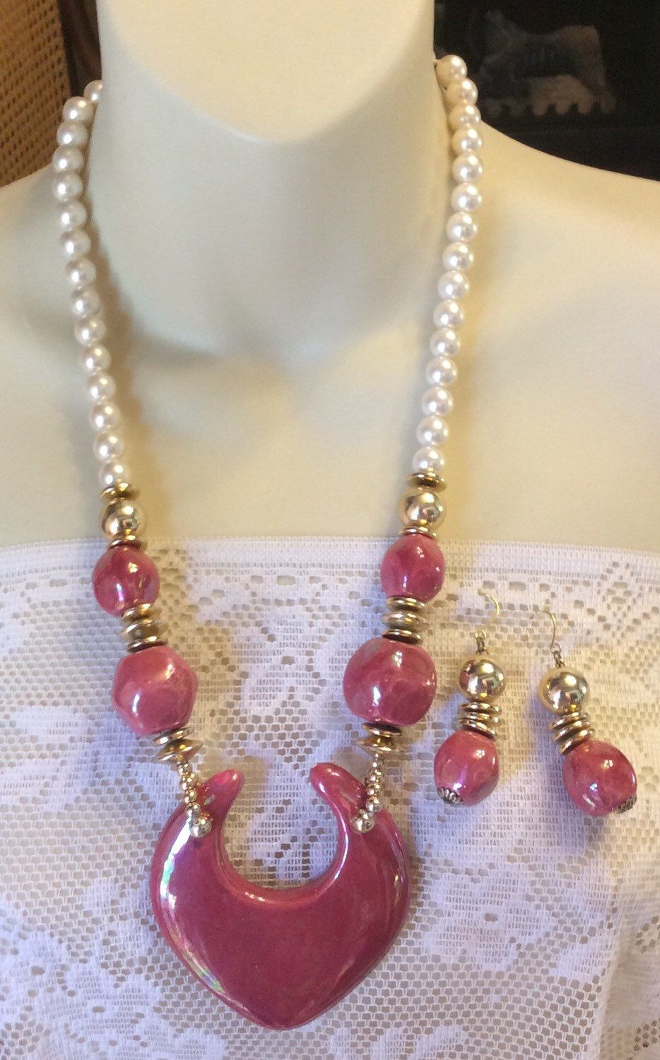 A personal favorite from my Etsy shop https://www.etsy.com/listing/236273540/vintage-pink-fuchsia-ceramic-pearl