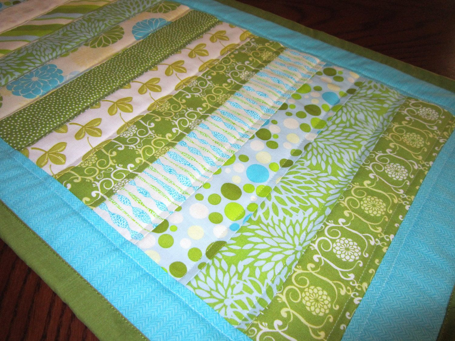 Quilted Table Runner   Make the strips a little wider and this would make a great quicky baby quilt.
