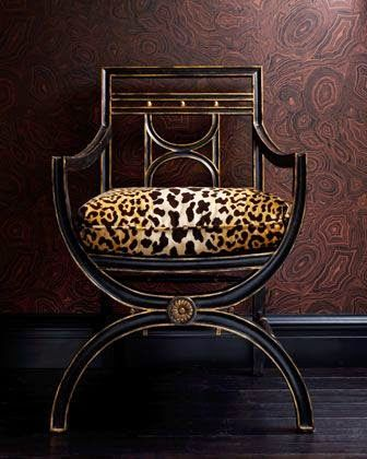 the french tangerine seeing spots animal print cushion on black