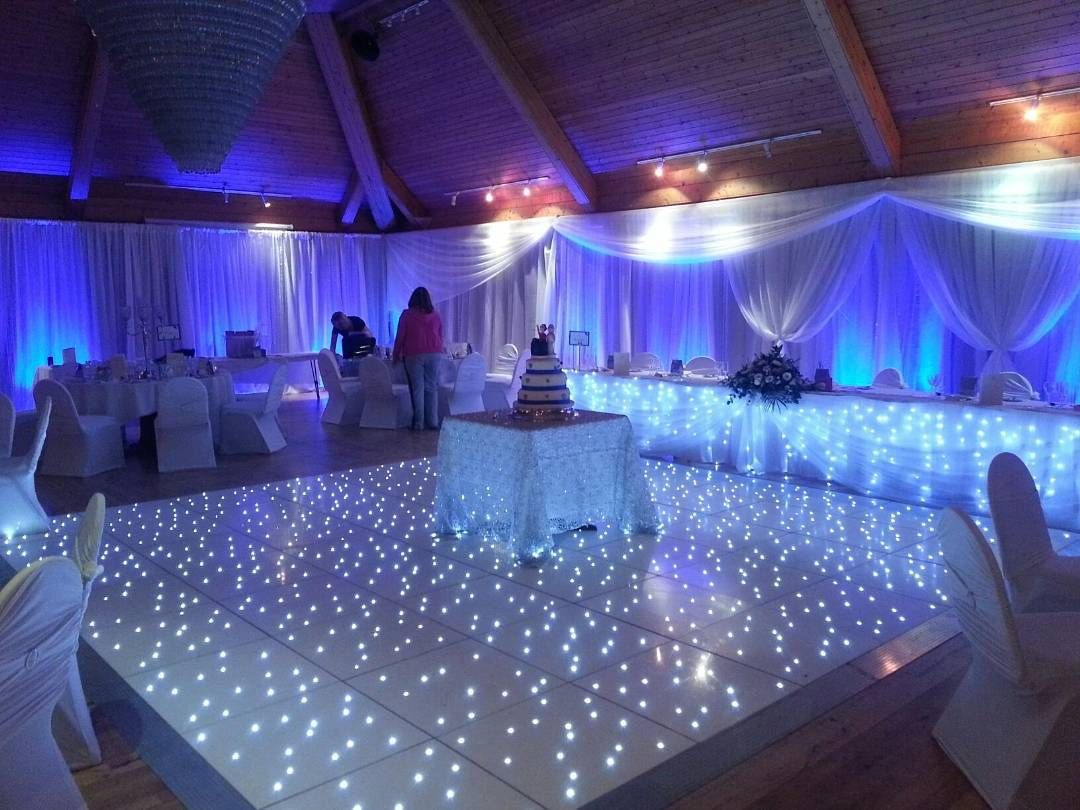 Love this LED dancefloor and white pipeanddrape set up