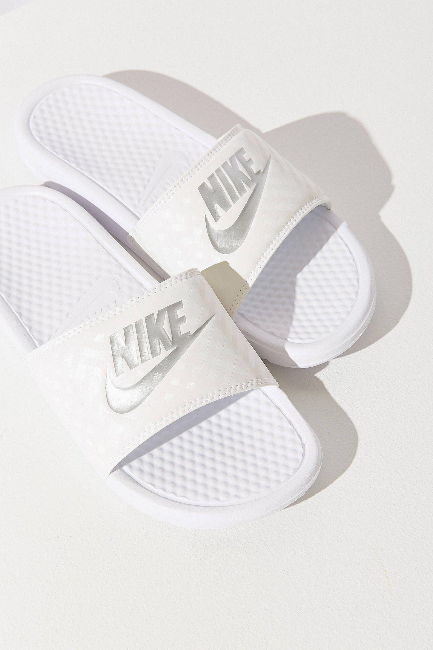 a12eaf21027e91 nike benassi JDI slide. urban outfitters. white.
