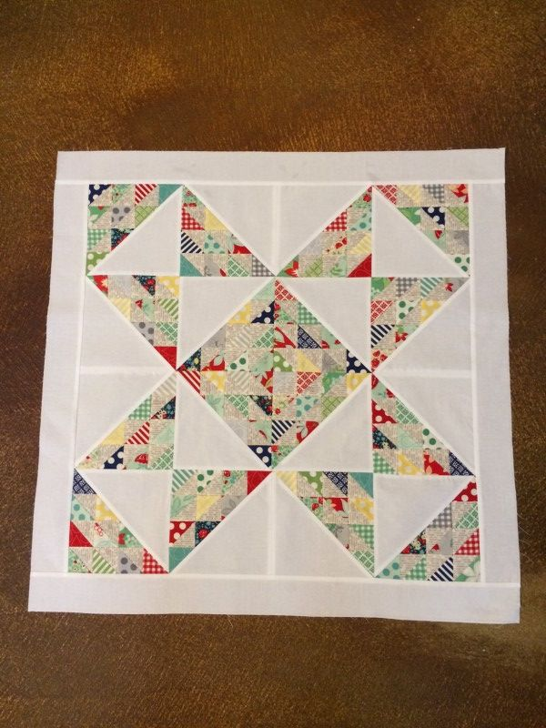 This would be a great layout for a kid's quilt. I would probably replace the white with a solid color or small pattern, though (in gray? or denim blue?) to hide kid stains.  |  Who loves candy? « modafabrics