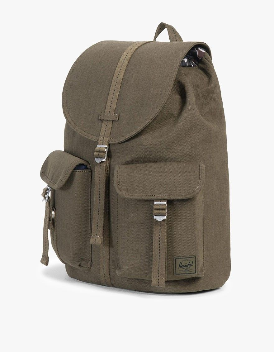 769ac13549 From Herschel Supply Co., the Surplus Dawson backpack in Army. Featuring  herringbone twill fabric construction, tiger camo liner, 13
