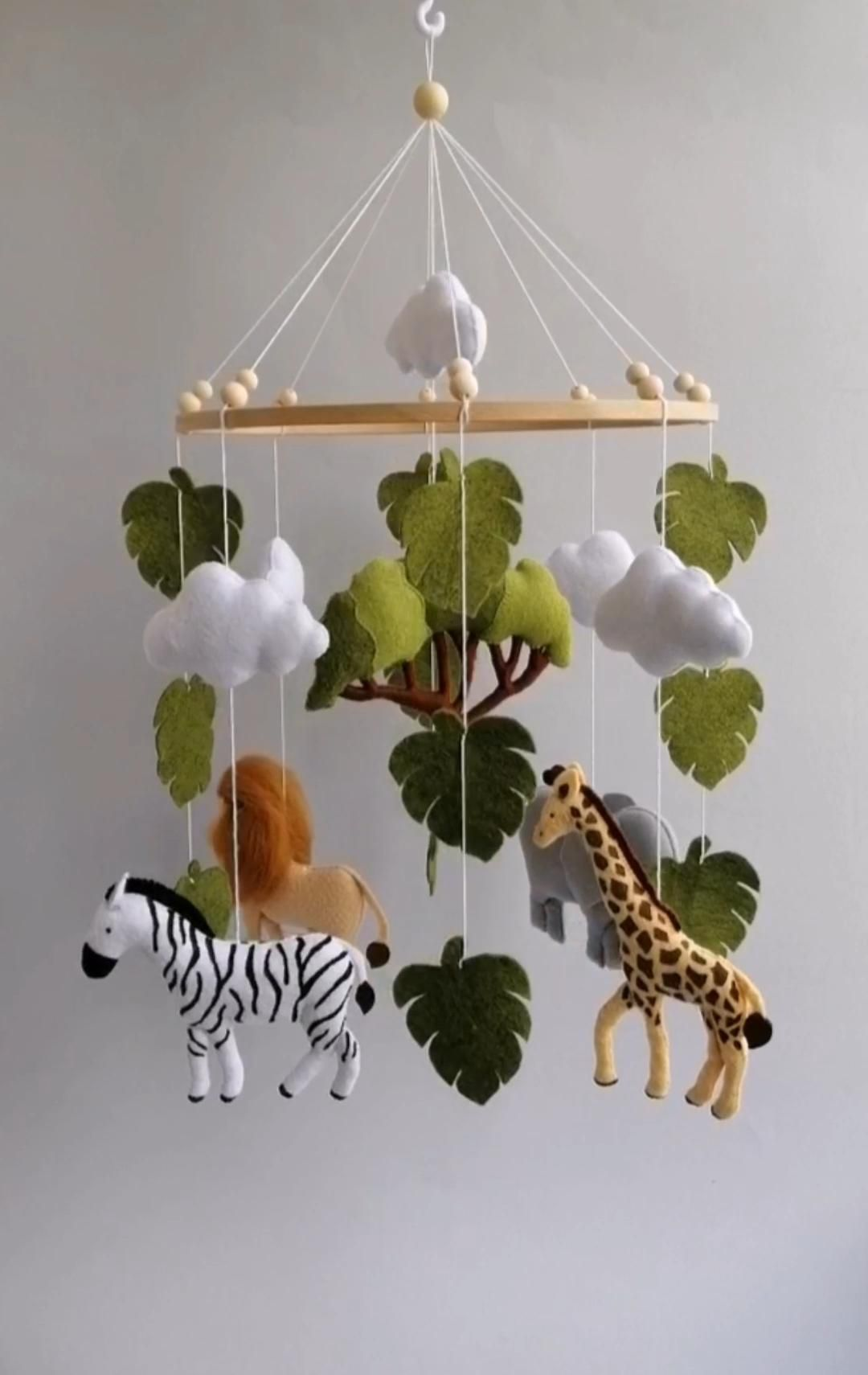 Safari animals mobile will perfectly match with baby girl, baby boy or gender neutral nursery.  Baby mobile is also a perfect gift for new baby or baby shower. _________________________________  African animals baby mobile includes:  1 lion  1 zebra  1 giraffe  1 elephant  1 African tree  5 clouds  Leaves  Height of main toys is about 5.9