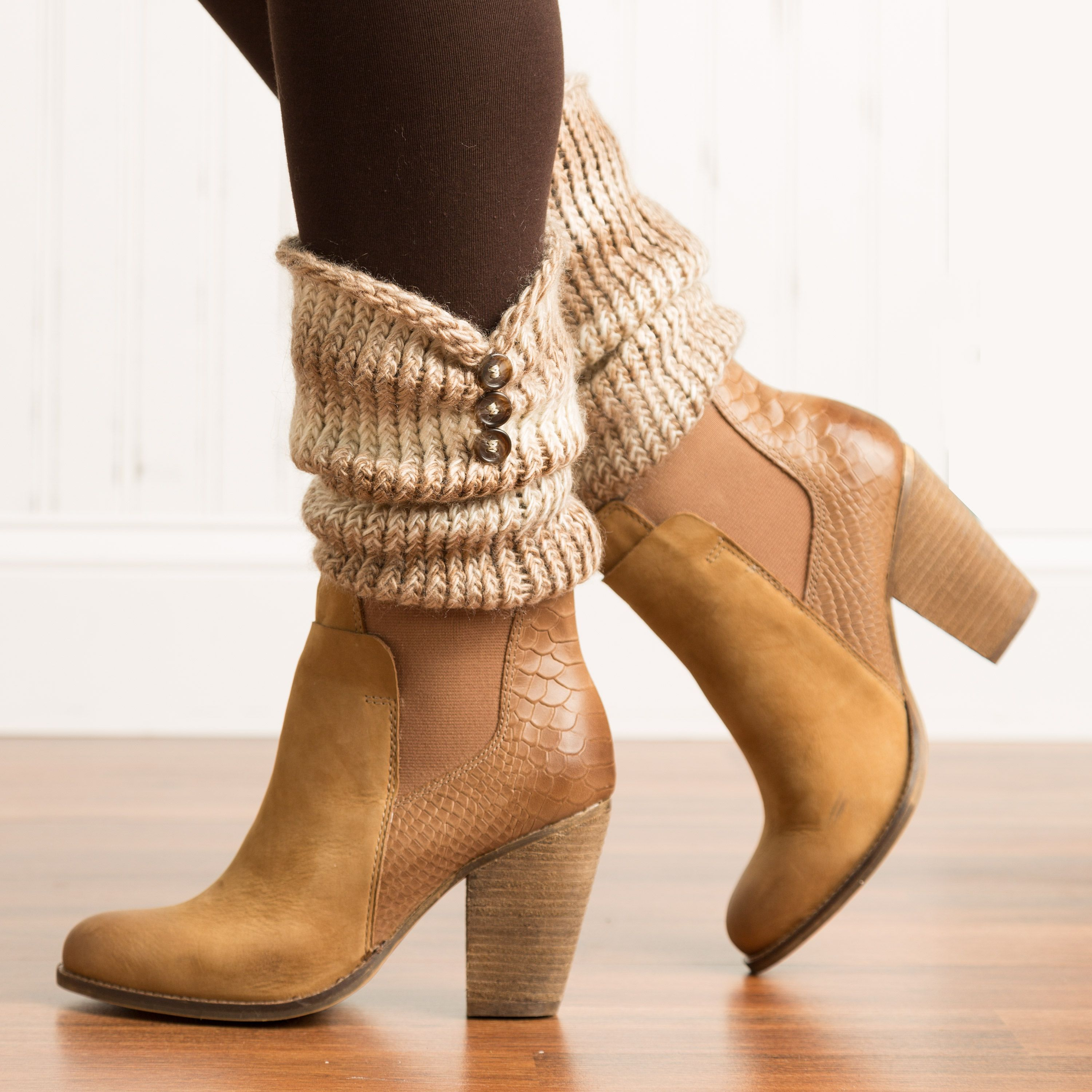 Make fashionable boot cuffs that are crazy easy with a knitting loom! A great accessory with a fashionable button trim finish. Find this free project at Simplicity.com. #bootcuffs