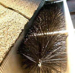 GUTTER BRUSH - I'VE HAD THEM IN MY GUTTERS FOR A COUPLE OF YEARS NOW. THEY ARE GREAT! RELATIVELY LOW COST, SUPER EASY INSTALLATION AND I NEVER HAVE TO CLEAN MY GUTTERS.