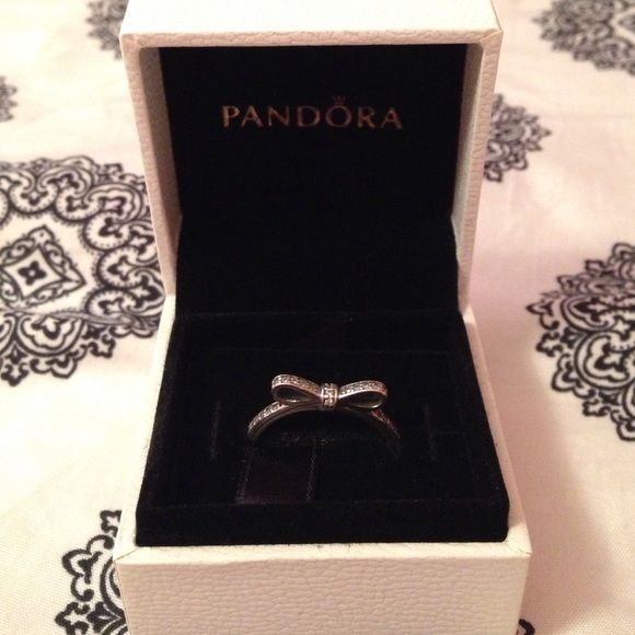 """Pandora Bow Ring Worn once, in perfect condition. Sterling silver Pandora Bow Ring. Sized as a Pandora """"60"""". In box! Pandora Jewelry Rings"""