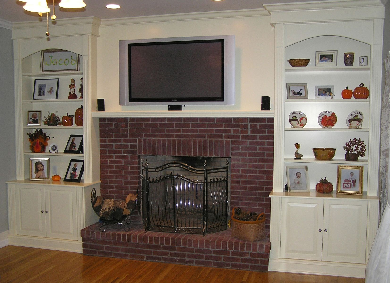 Custom made fireplace remodeling and bookcases living room