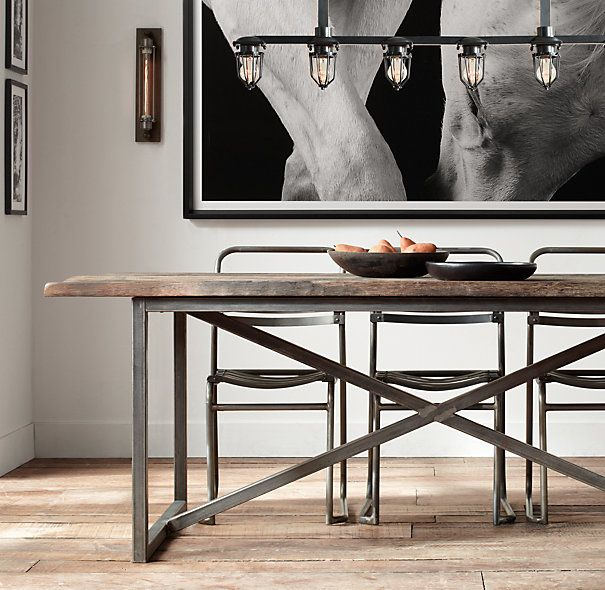 Industrial lighting  wood table with metal frame create an inviting and  masculine dining space. RH s Salvaged Boatwood Rectangular Dining Table In the hands of