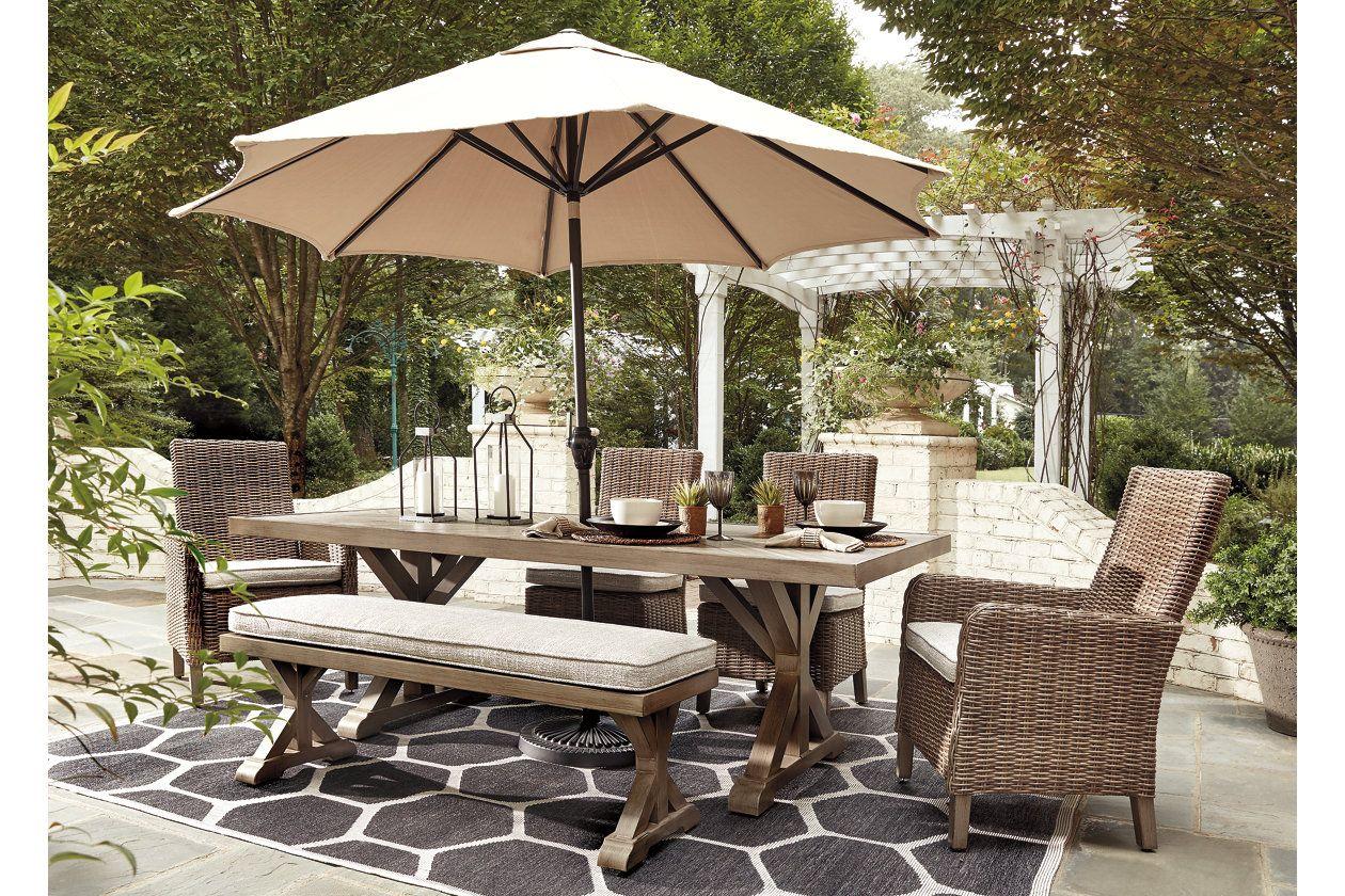 Beachcroft Dining Table With Umbrella Option Ashley Furniture Homestore Patio Dining Set Outdoor Patio Set Outdoor Dining Set