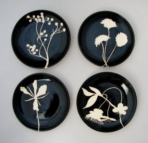 The floral designs on these plates and bowls came from experimentation with multiple flower forms I was painting and carving while