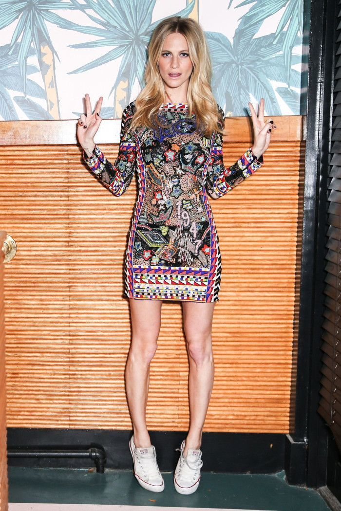 Love Christmas Party Dresses But Hate The Heals? Go Poppy Delevingne Style And Replace The Stilettos With Converses