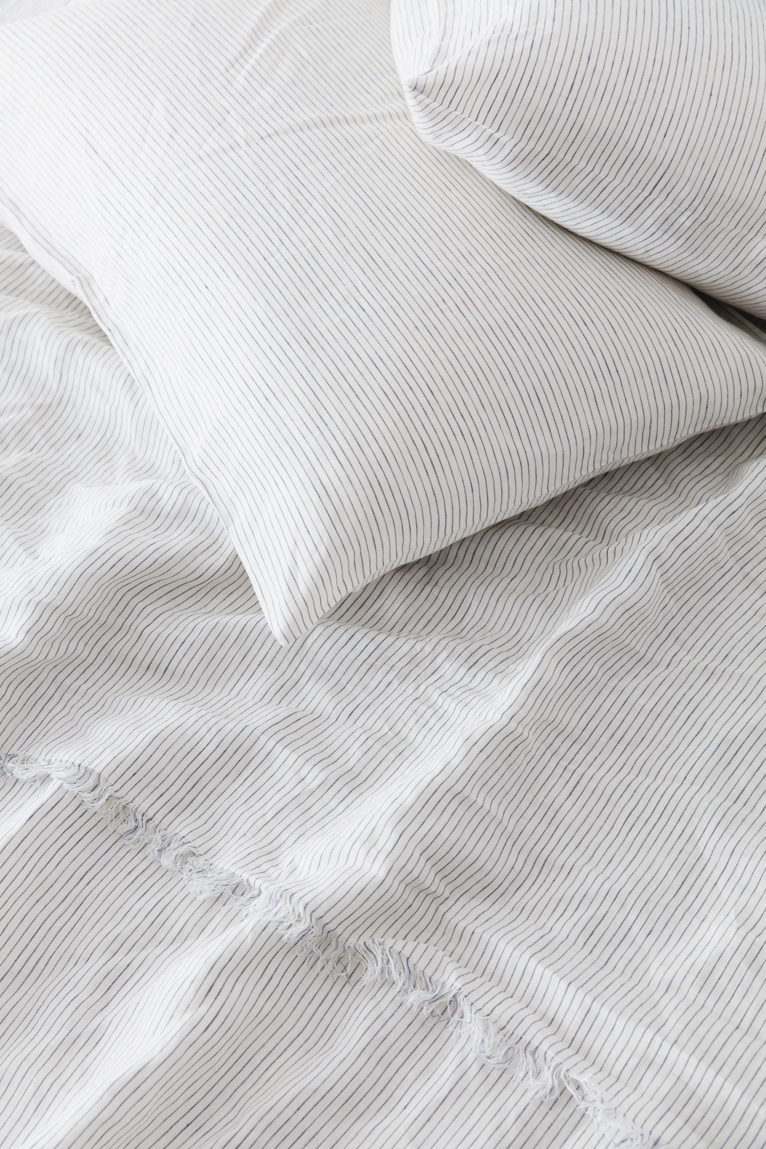 Blue stripe sheet set with delicate eyelash fringing details