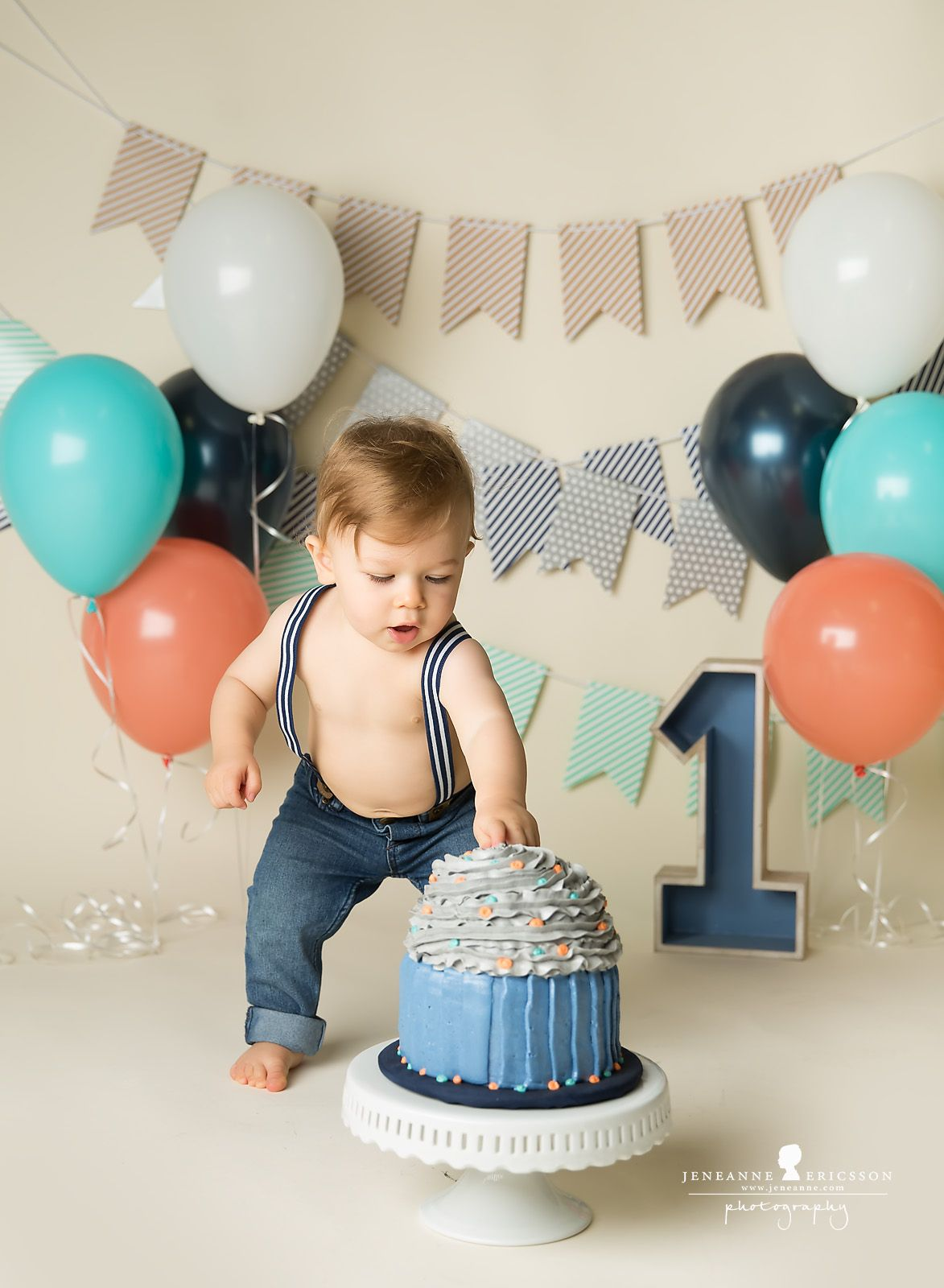 blue orange teal and grey first birthday boy cakesmash