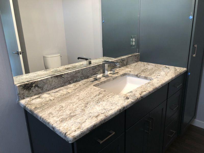 Blue Dunes Leathered Granite Vanity Top With Matching Granite Back Splash Granite Vanity Tops Kitchen Remodel Countertops Leather Granite