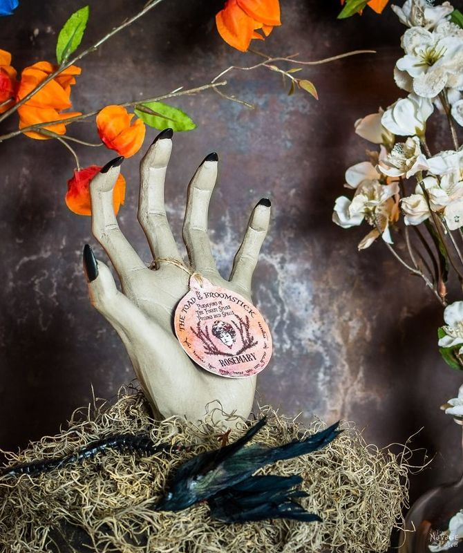 A woman presses foam into a planter and wait until you see her - halloween props decor