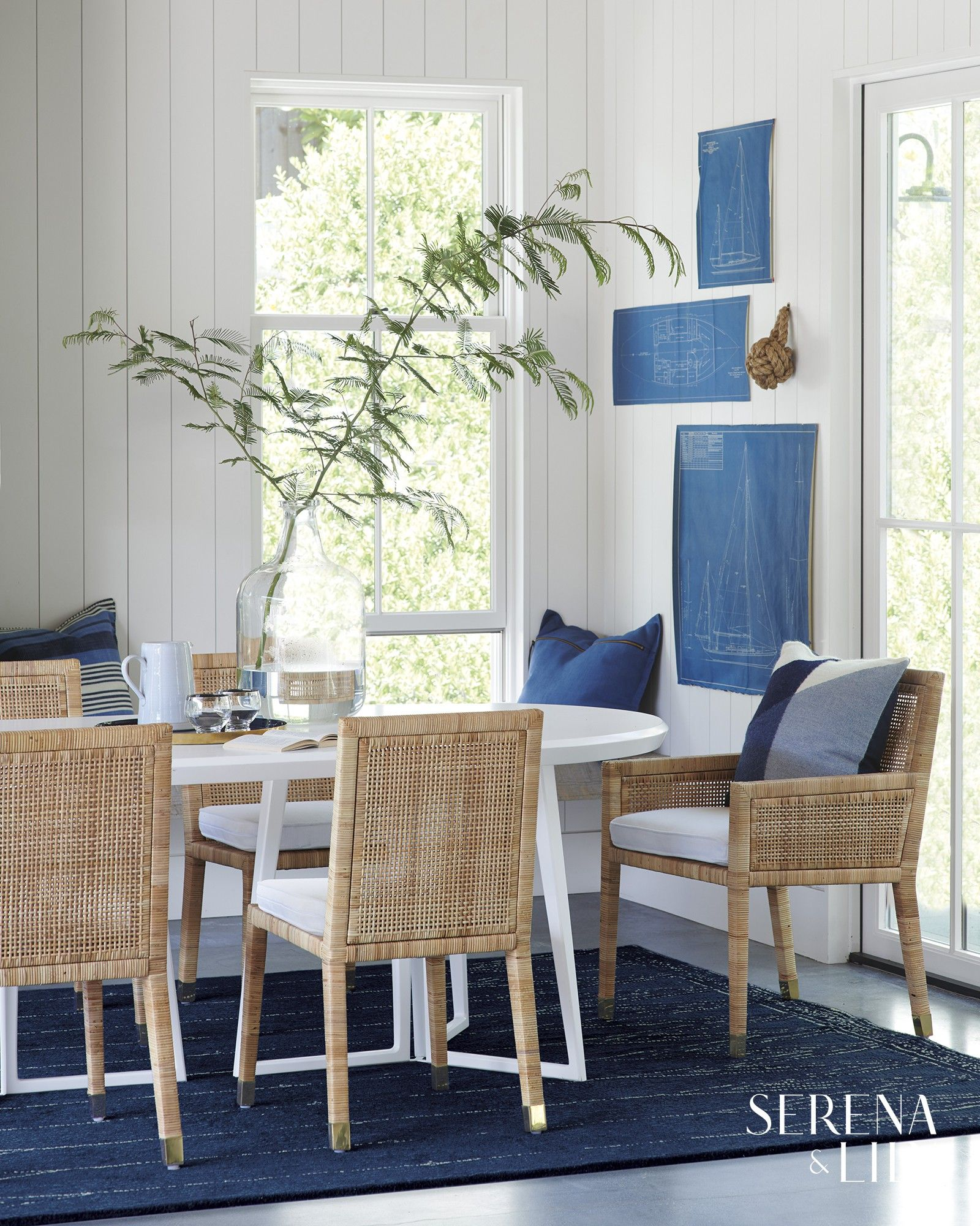 We Love How Our Oval Table Softens The Angles In This Blue And White Nautical Dining Room A G Coastal Dining Room Nautical Dining Rooms Oval Dining Room Table