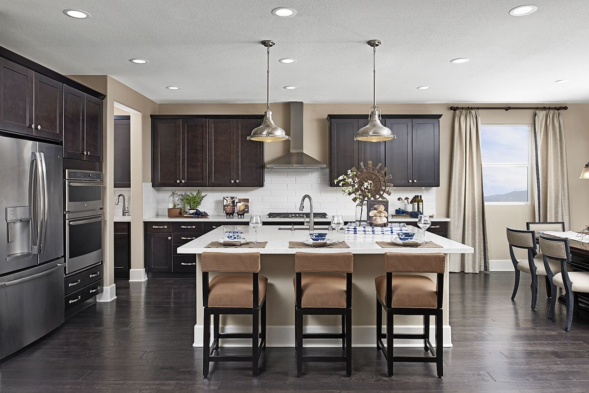Stainless-steel appliances & complementary pendant ... on Model Kitchen Ideas  id=56930