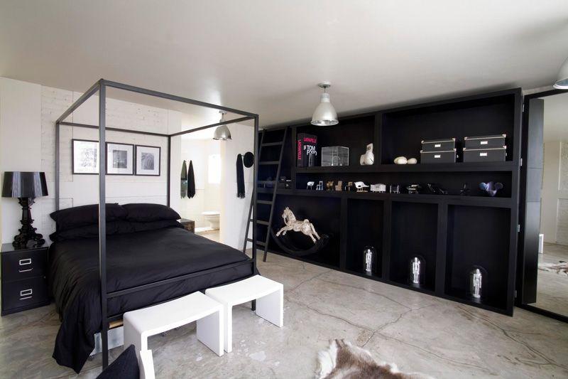 concrete floor black canopy bed black wall unit kababie arquitectos
