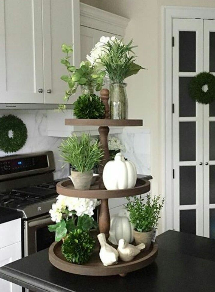 Love. Love. Love seeing interesting ways to decorate using cake stands. Repinned…