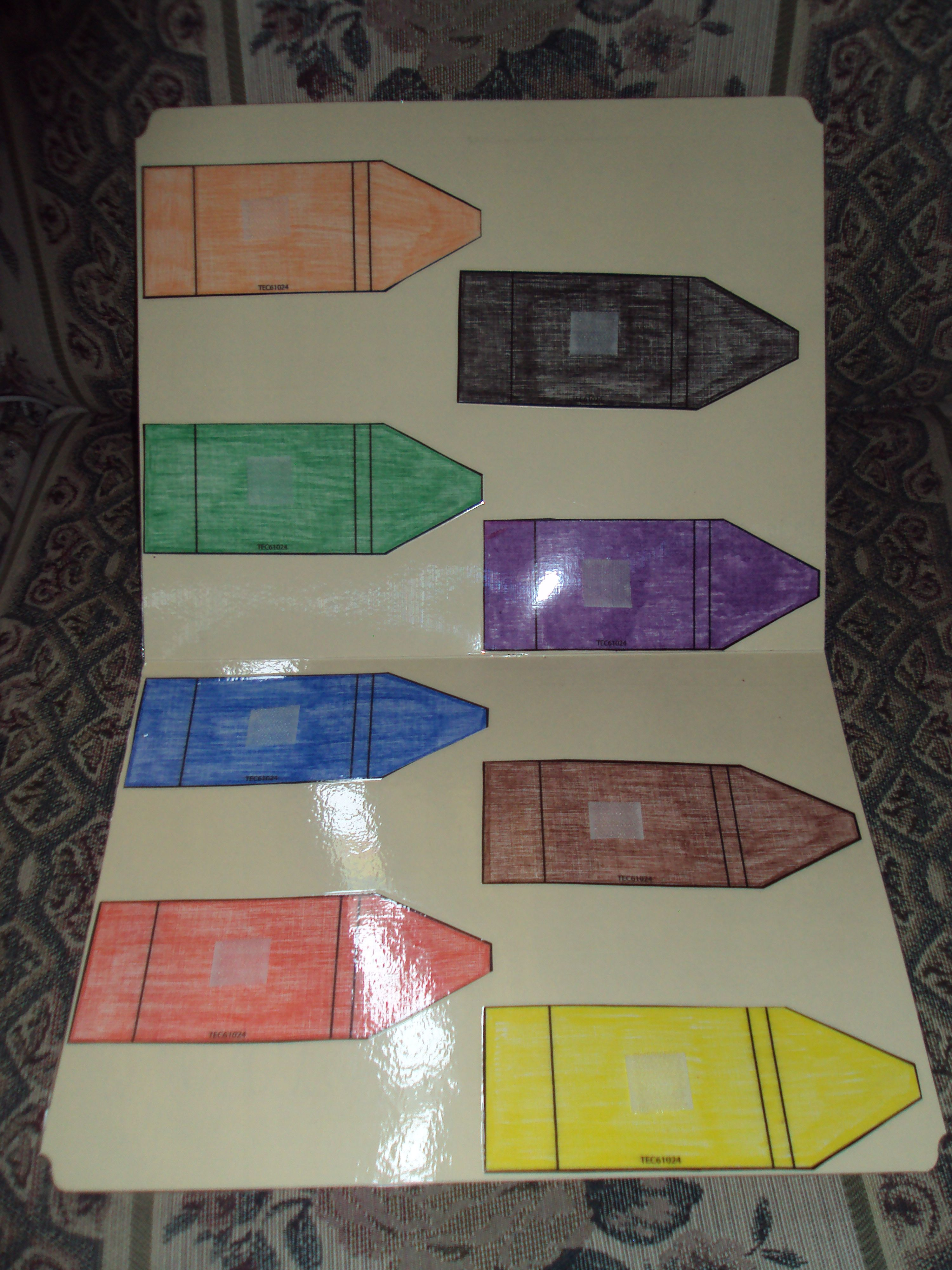 color and glue crayon patterns to file folder. laminate and attach ...