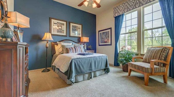 Blue-themed bedroom by Darling Homes at Sienna Plantation