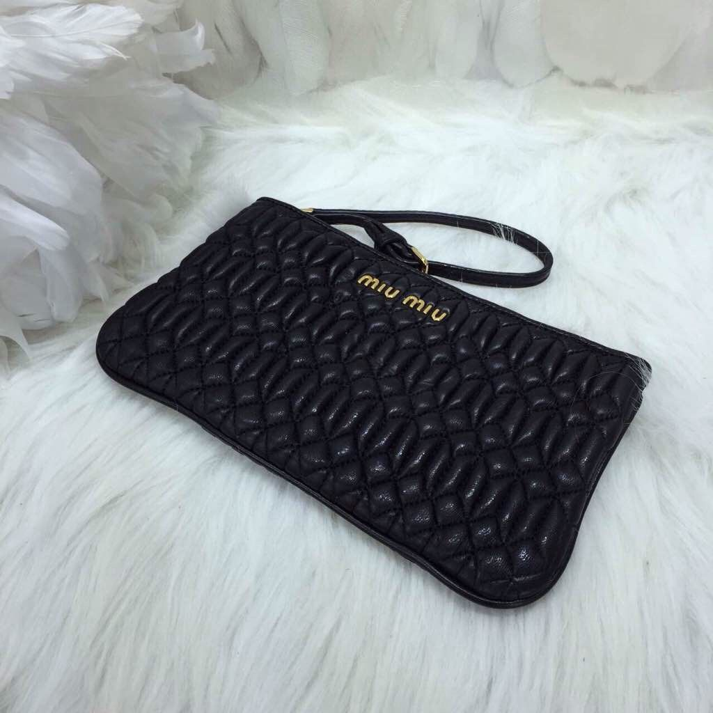 7df8a798f084d Miu Miu Matelassé nappa leather wristlet clutch Black   Miu Miu ...