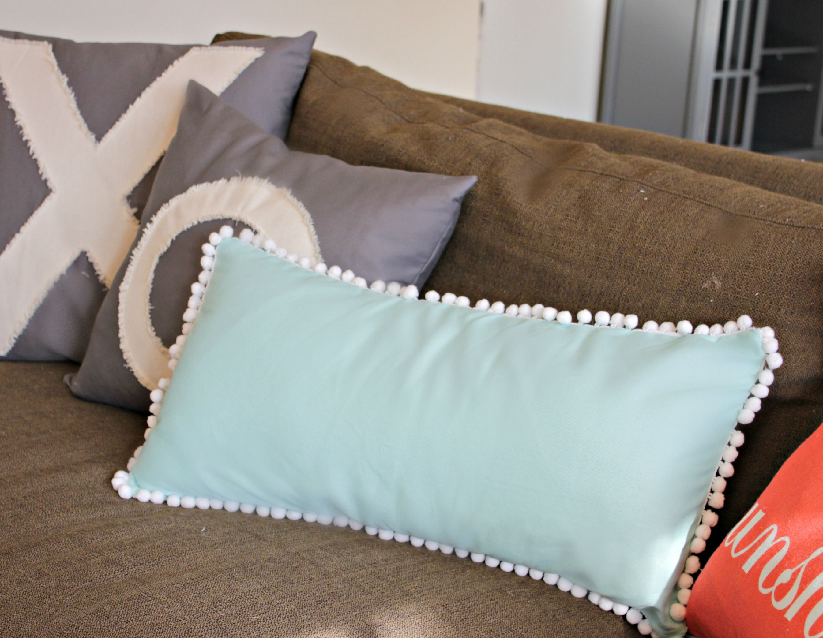 An easy sewing tutorial on how to sew a pom pom pillow. I\u0027ll & Easy Pom-Pom Pillow Tutorial | Pom pom trim Pillows and Tutorials pillowsntoast.com