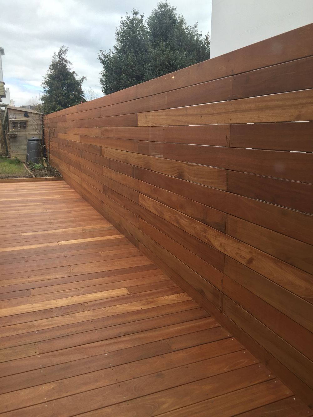 Horizontal wood fence yellow balau deck boards finished for Outdoor decking boards