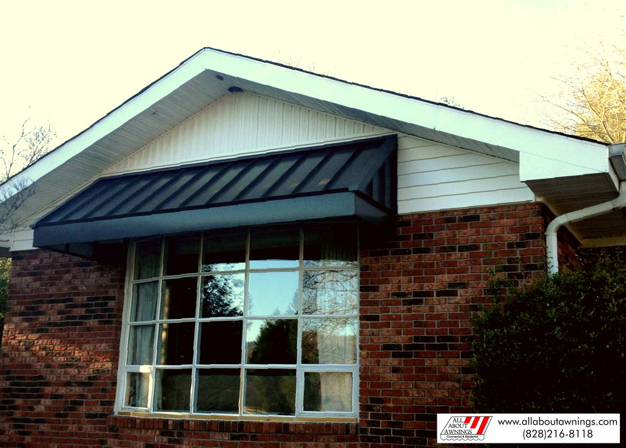 Standing seam metal awning for window.